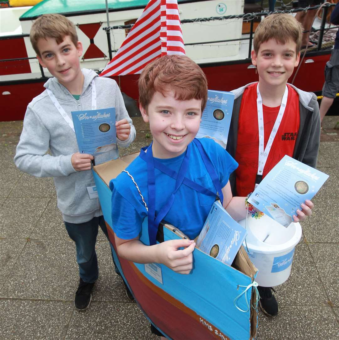 From left, George, 13, Sammy, 12 and Edward, 10 handing out leaflets for Snowflakes, a charity at the Maidstone River Festival 2019. Picture: John Westhrop