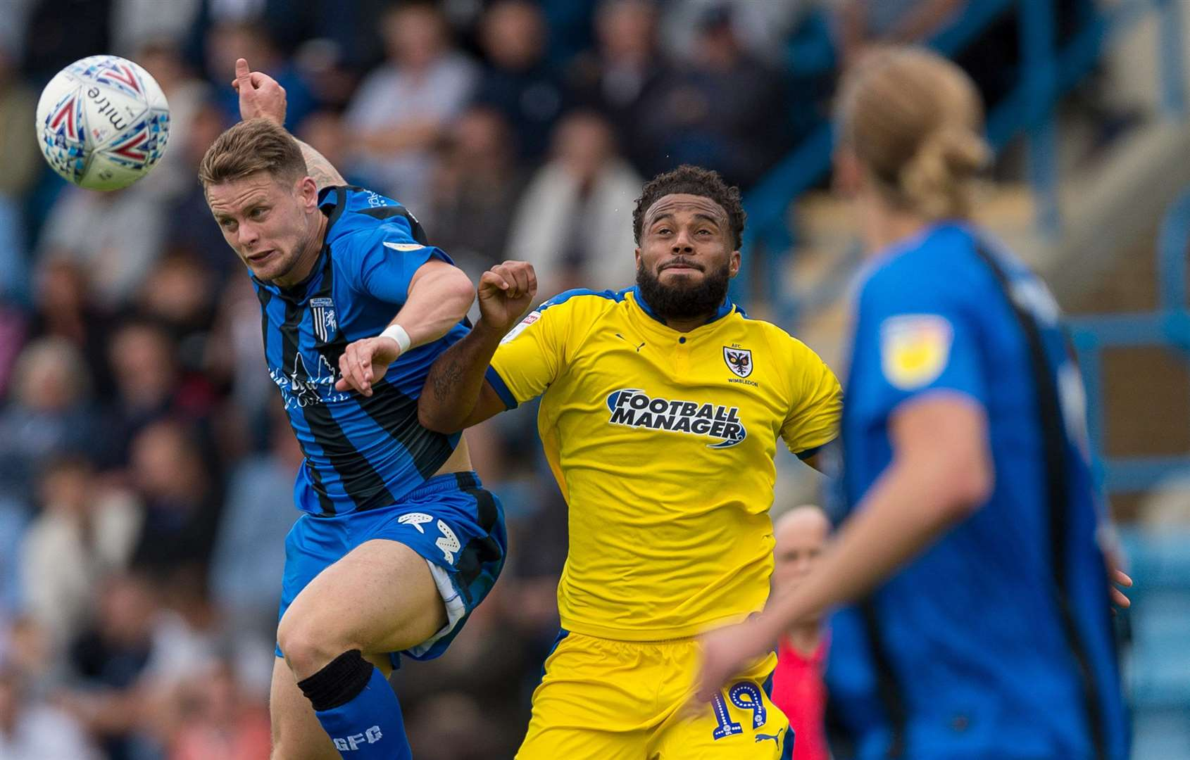 Gills' Mark Byrne challenges with Tom Soares Picture: Ady Kerry