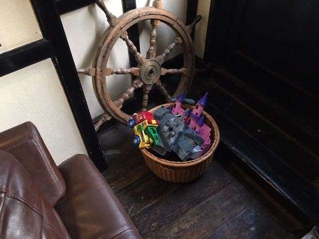 Behind my perfect sofa spot, alongside the ship's wheel, was a collection of kids toys and when I returned I'm pleased to say they were all in use