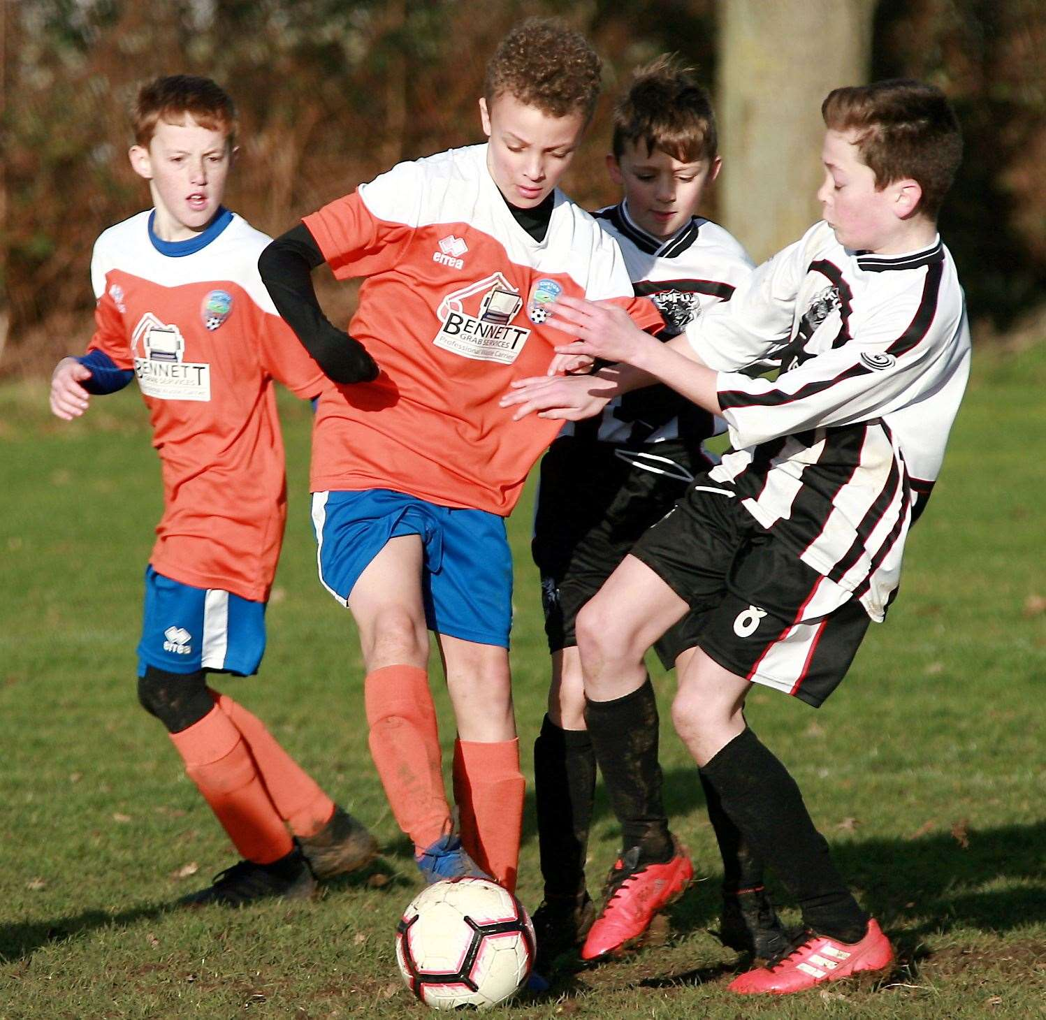 Cuxton 91 Dynamos under-12 (orange) take on Milton and Fulston United Zebras under-12s. Picture: Phil Lee FM26563351