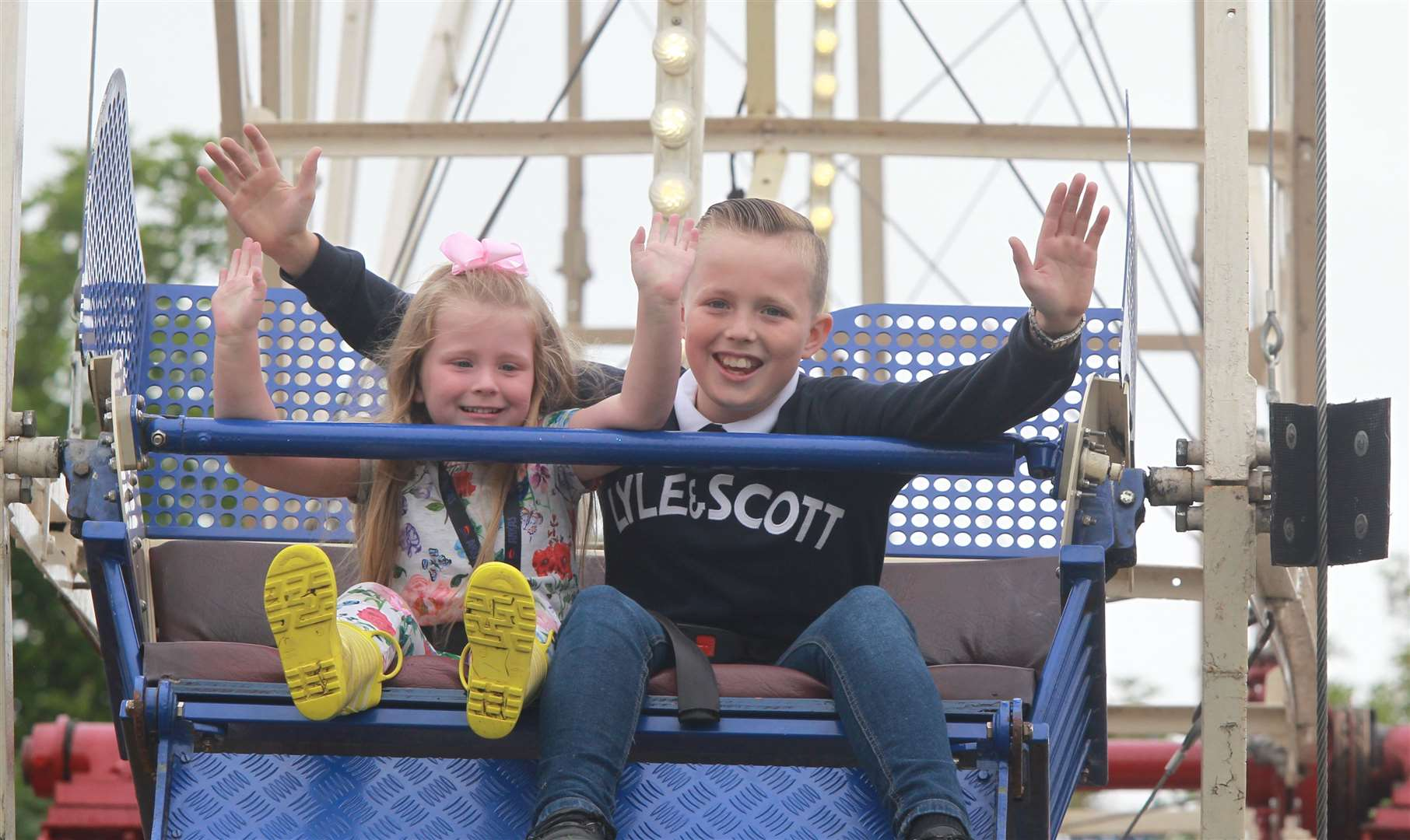 Grace Brooker, four with her brother, Lee, 12 on the big wheel at the Kent County Show Picture: John Westhrop