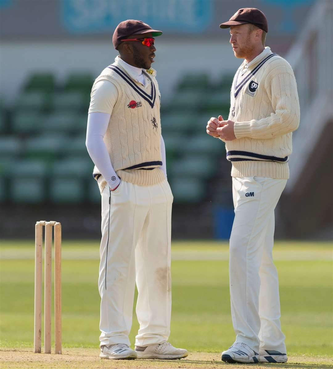 Adam Riley, right, talks to acting skipper Daniel Bell-Drummond during the game against Loughborough MCCU at Canterbury Picture: Ady Kerry