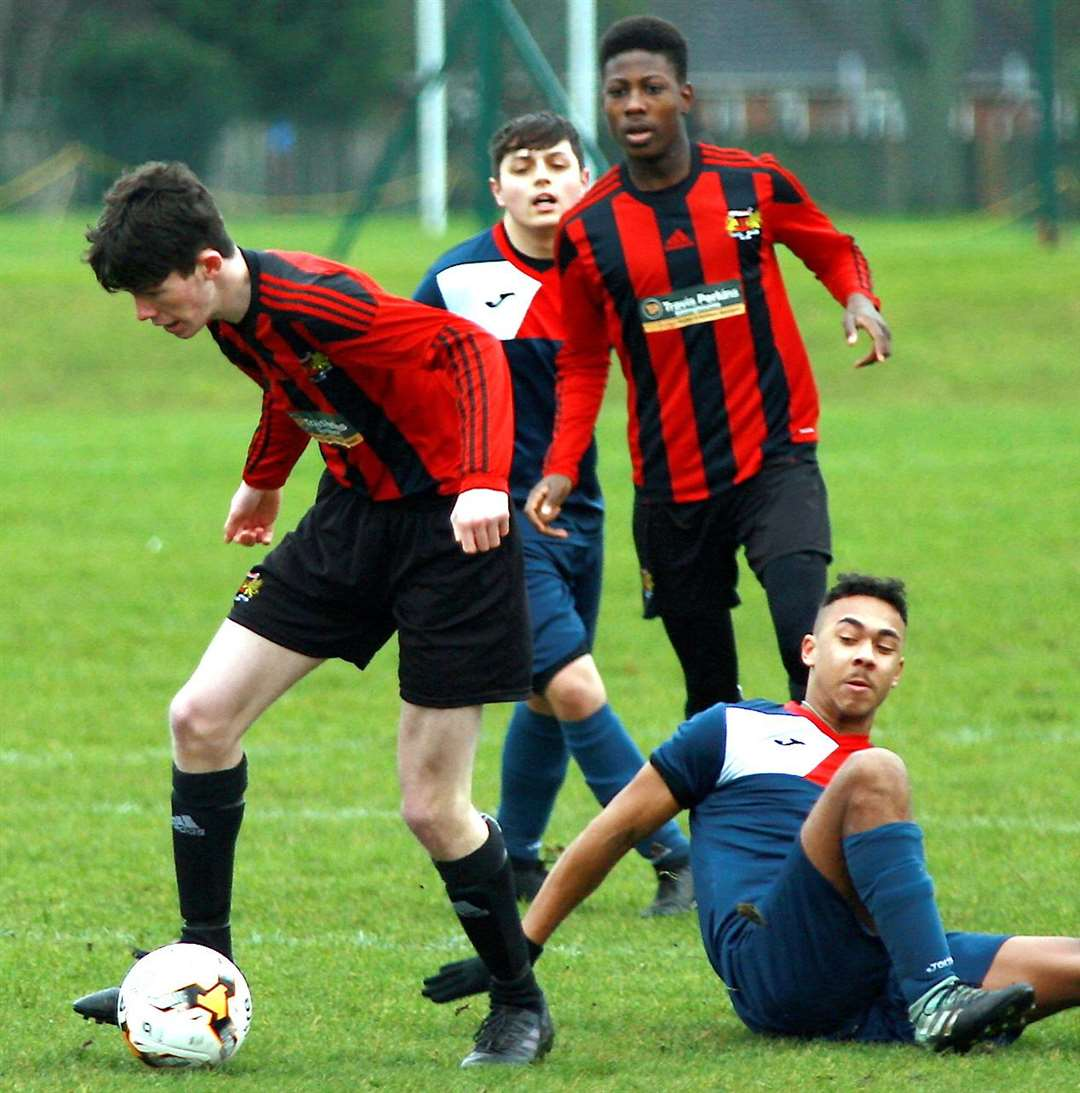 Woodcoombe Youth (stripes) battle it out with Hempstead Valley in Under-18 Division 1 Picture: Phil Lee