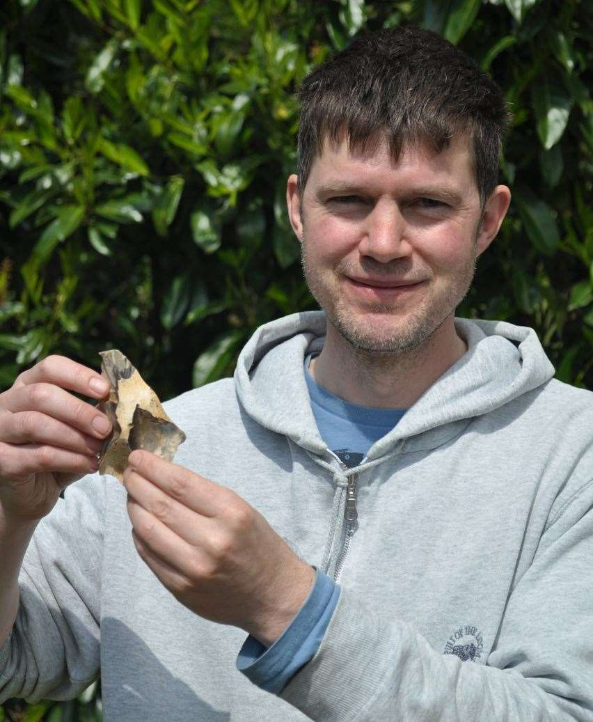 Dr Francis Wenban-Smith and one of the Neanderthal flint tools discovered in Swansombe. Photo: Oxford Archaeology and the University of Southampton