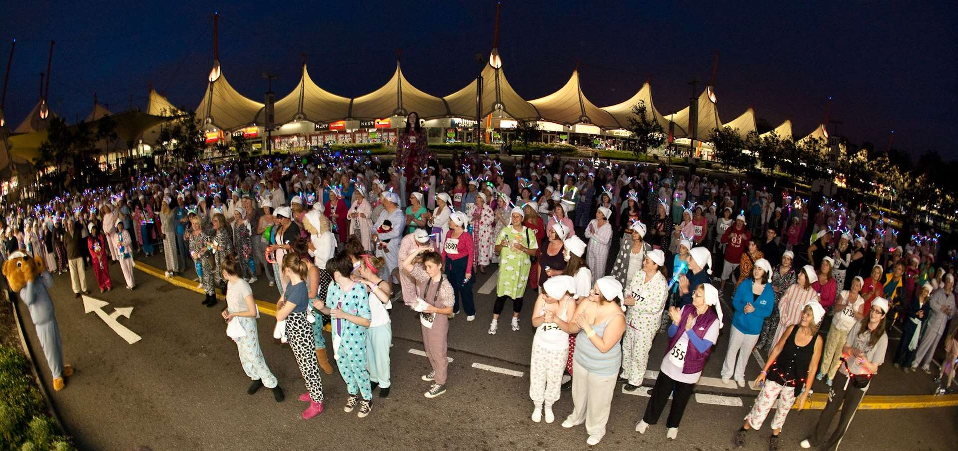 Pilgrims Hospice Pyjama Walk participants limber up for the event at the Ashford Designer Outlet in 2012