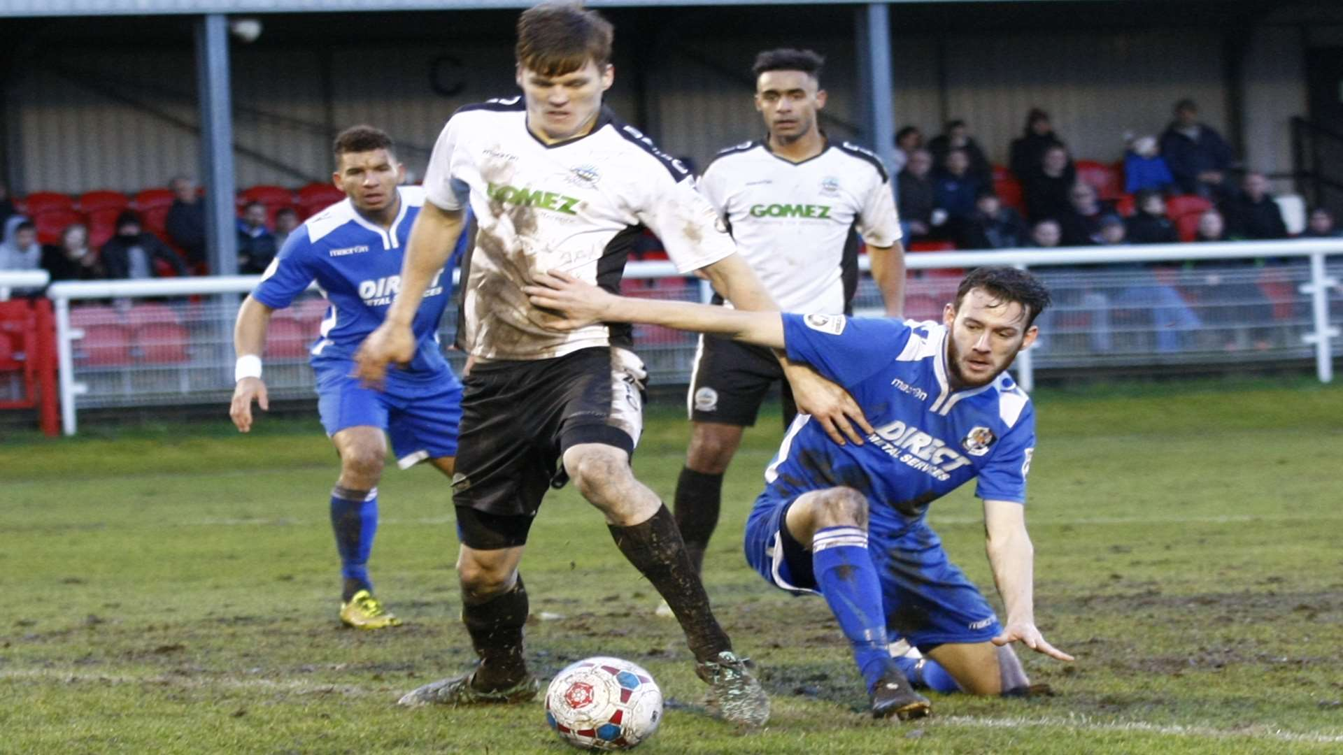 Sean Raggett in the thick of the action against Dartford earlier this season