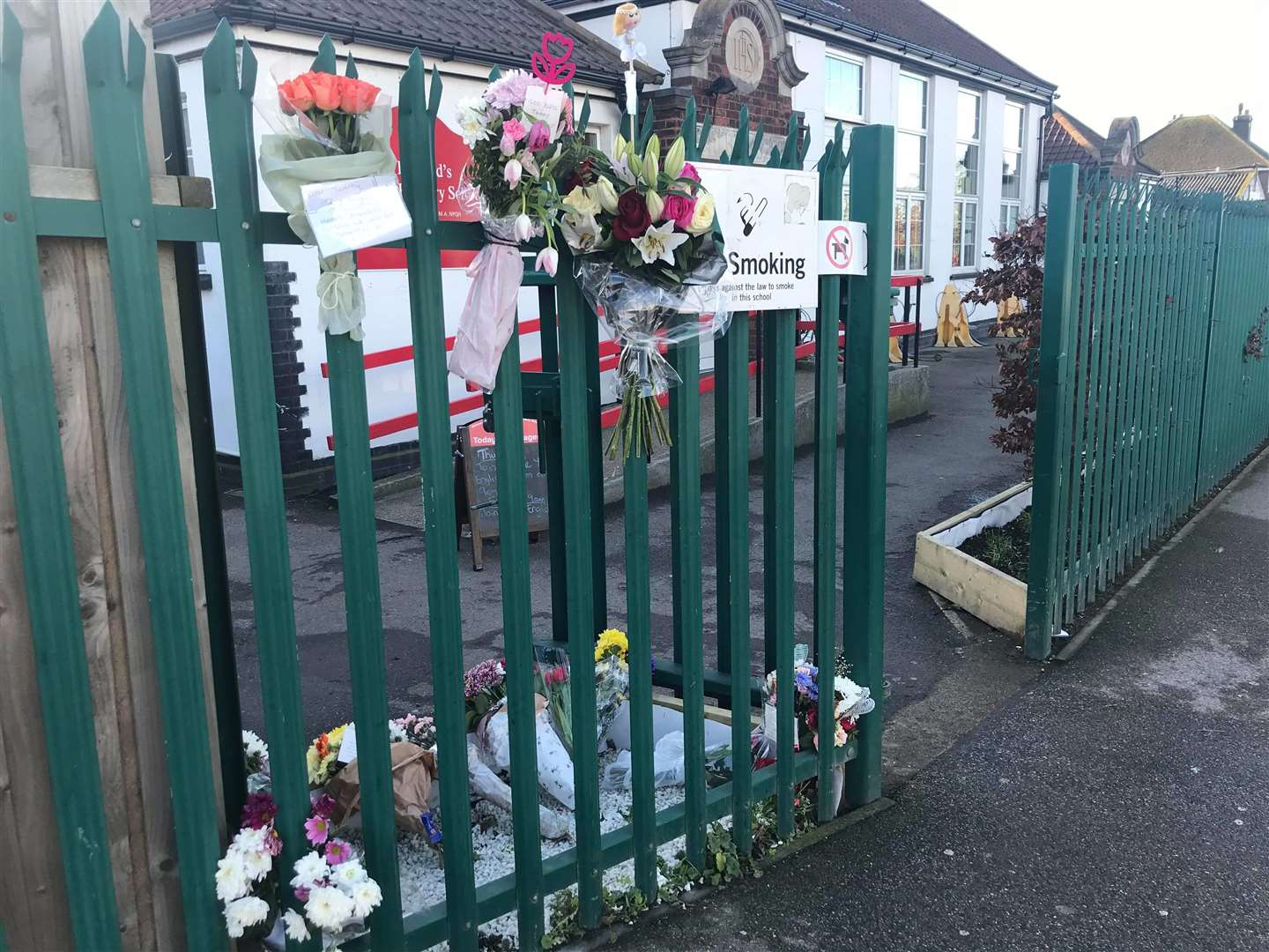 Floral tributes have been left outside St Edward's Primary School in Sheerness