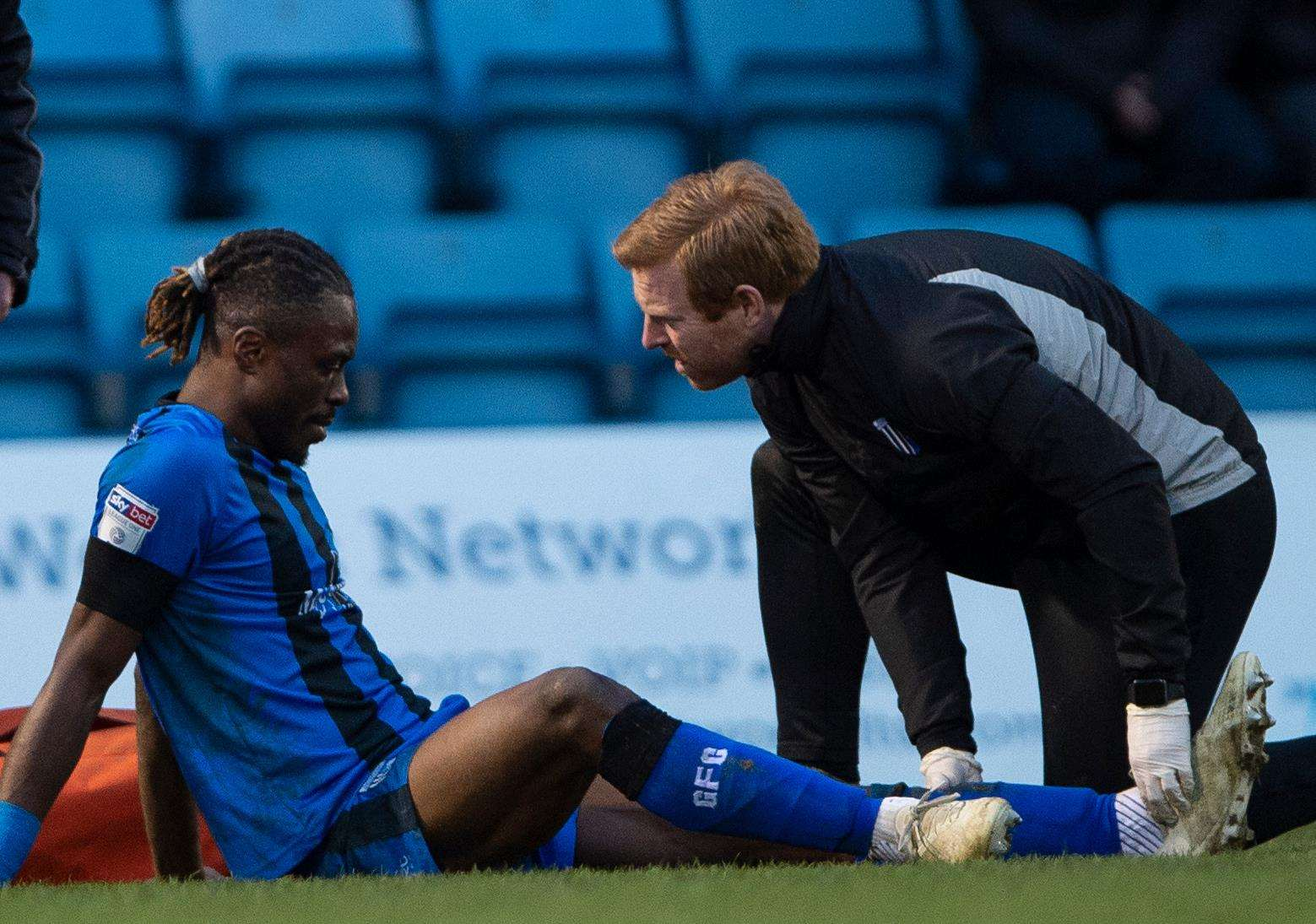 Physio Gary Hemens treats Gabriel Zakuani after suffering an ankle injury Picture: Ady Kerry