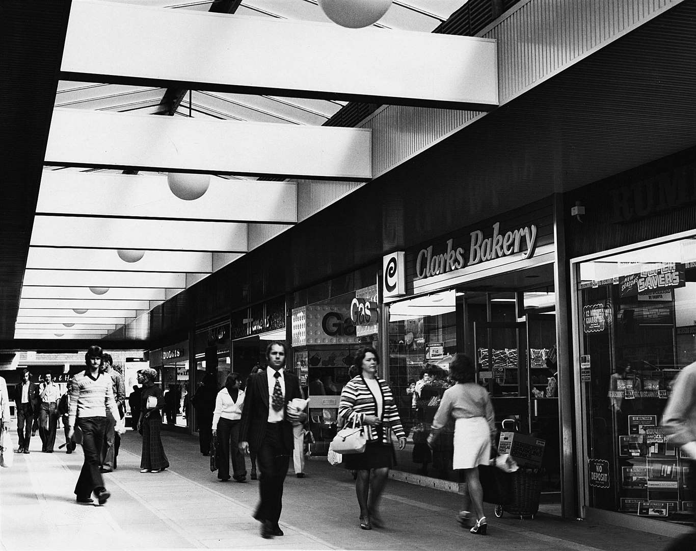 Flares, bell bottoms and kipper ties were all the rage in this 1975 shot in the early days of the Tufton shopping centre. Picture: Steve Salter