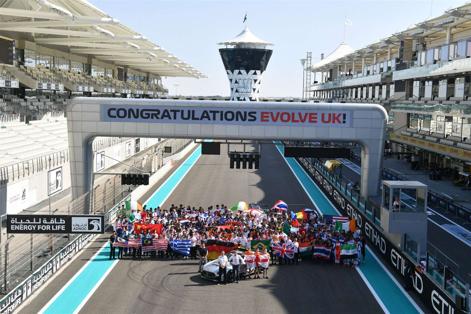 F1 in Schools finalists celebrating on the grid at the Yas Marina Circuit in Abu Dhabi