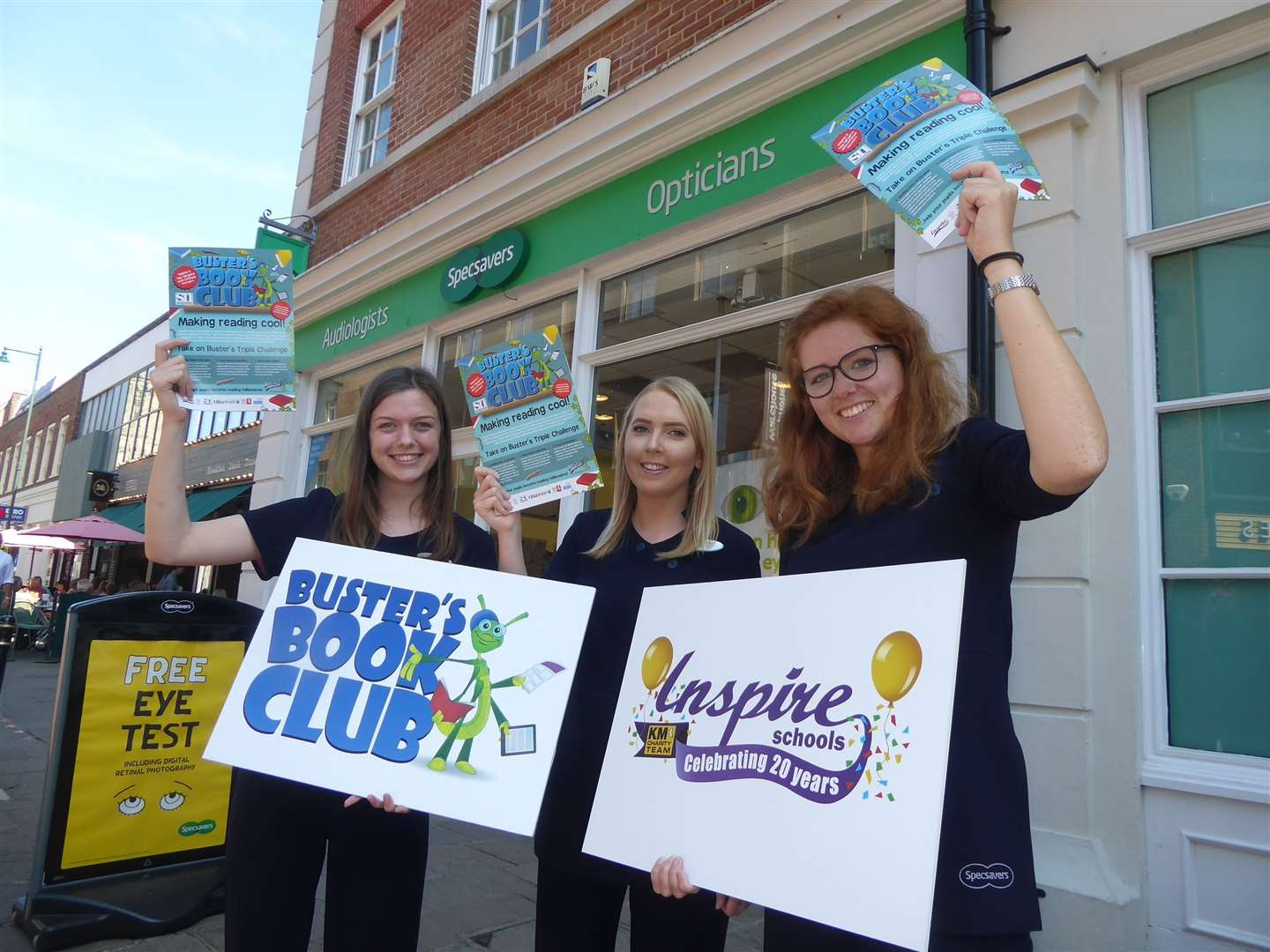 Aine Tainsh, Chloe McGregor and Jess Homes of Specsavers Canterbury branch promote Busters Book Club. (16017387)