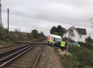 The van with its bonnet smashed is knocked to the side of the tracks at Teynham. Picture: British Transport Police