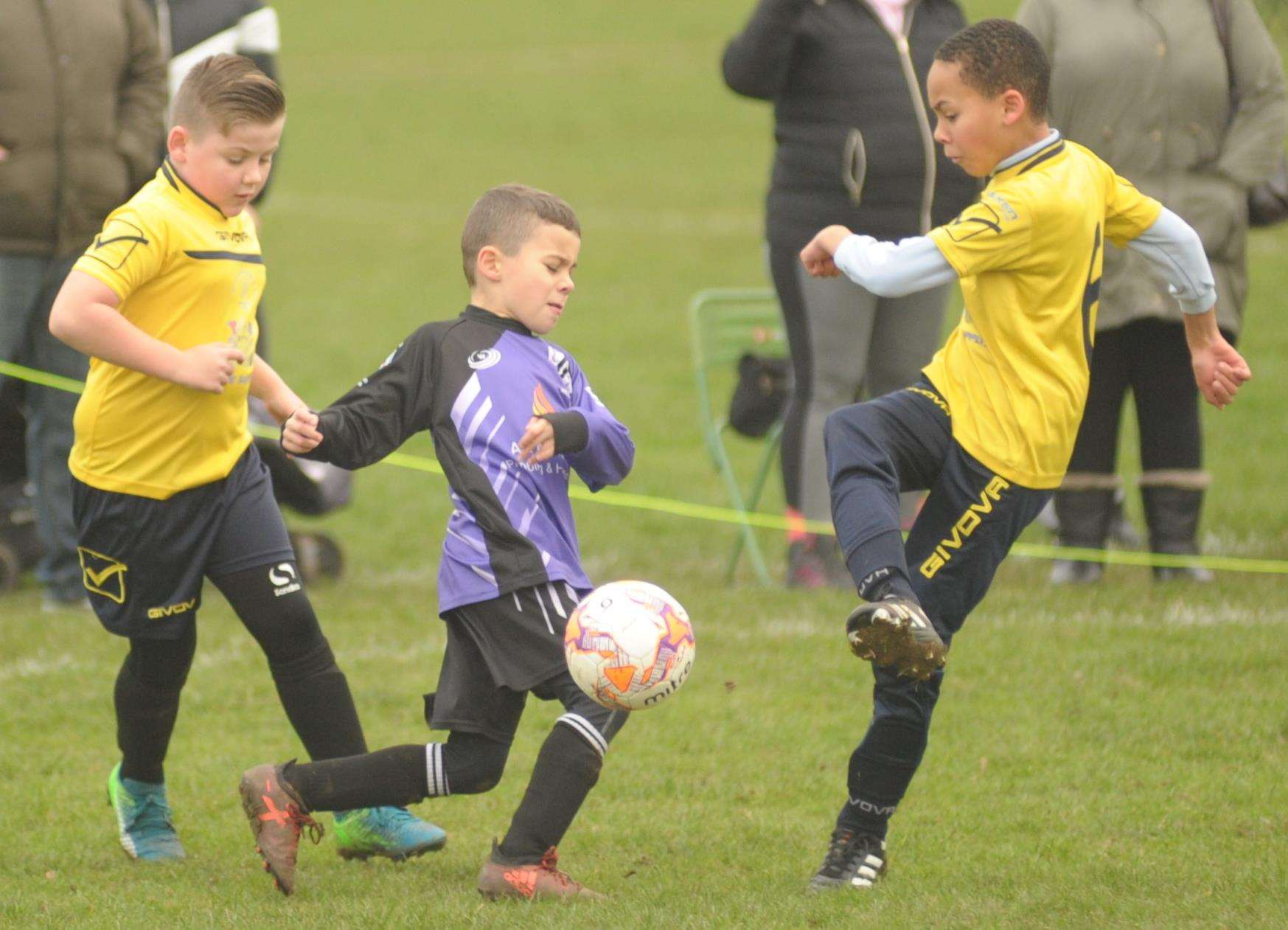 Anchorians Jaguars under-9s (purple) and Sheerness East Youth fight for the ball Picture: Steve Crispe