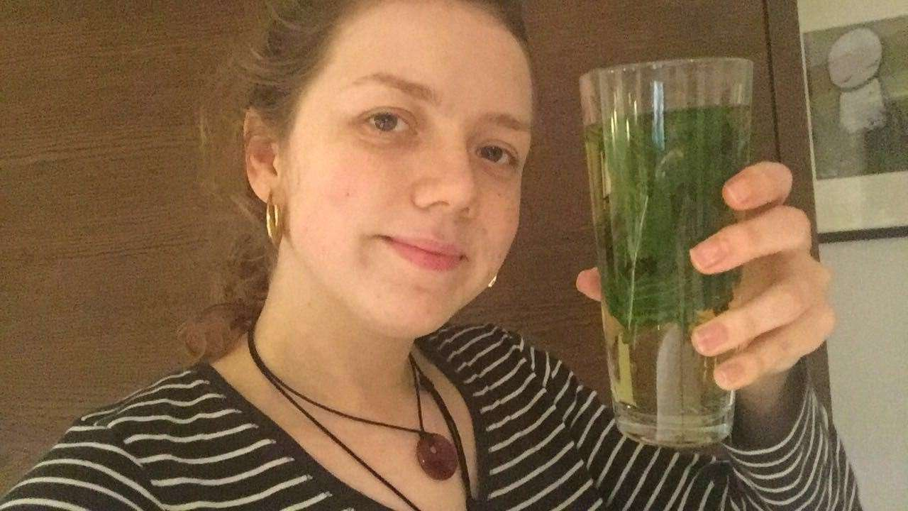 Me with a glassful of fresh nettle tea - cheers