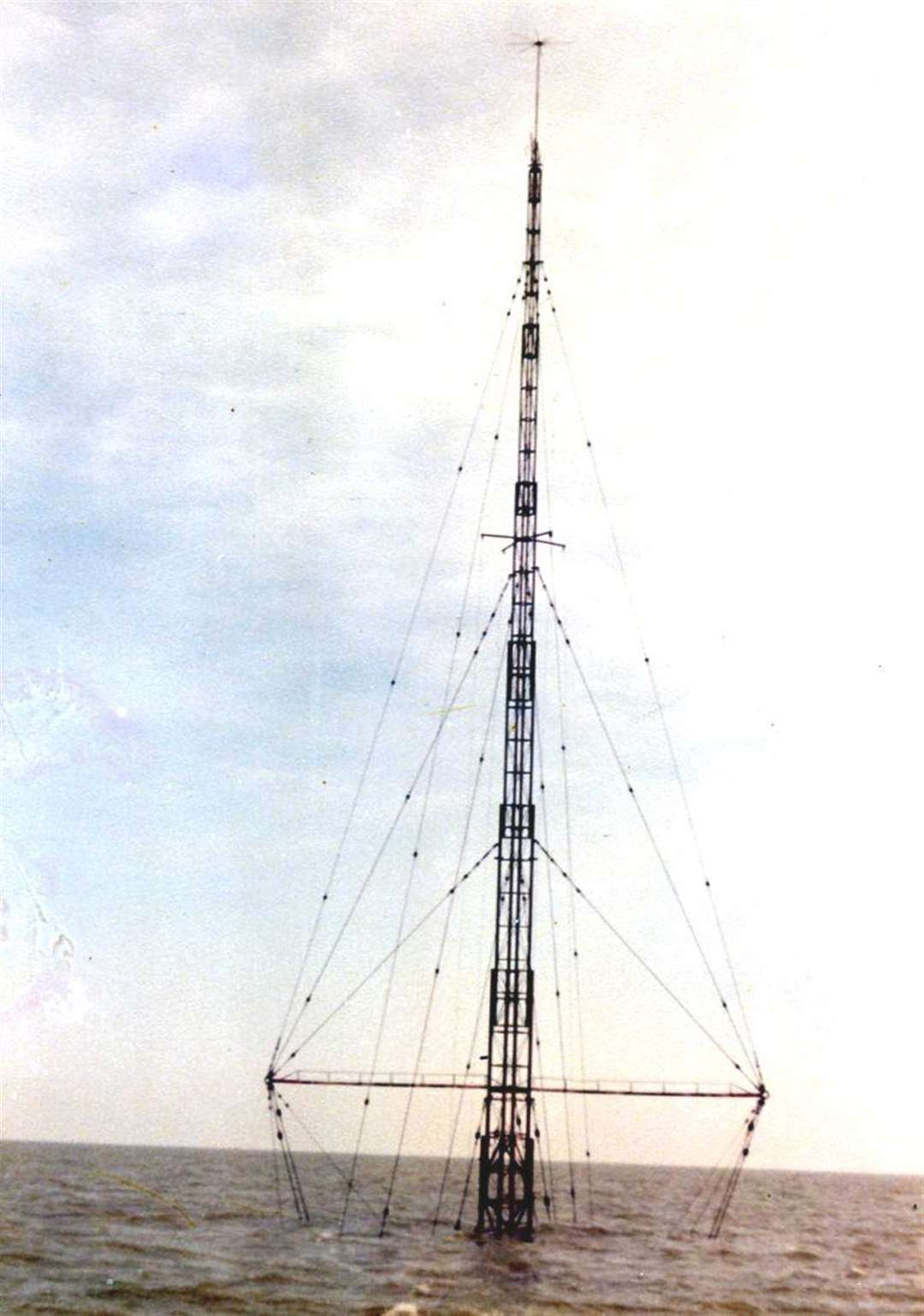All that remained visible above the waves of Radio Caroline's Mi Amigo was the mast