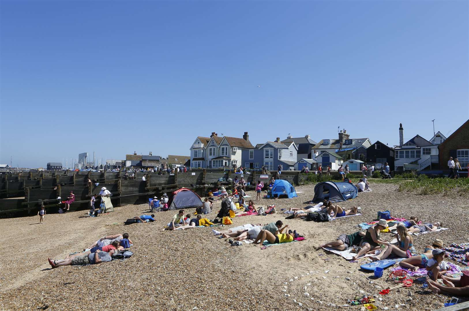 Beachgoers enjoying the sunshine in Whitstable