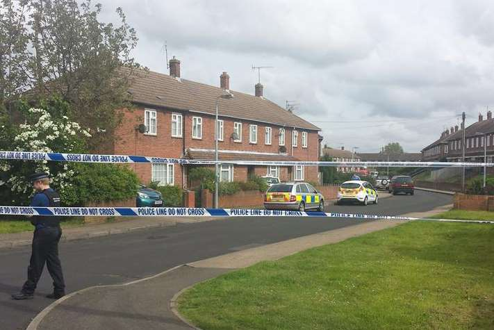Police at the scene of the four-hour siege where Christopher Smith was detained