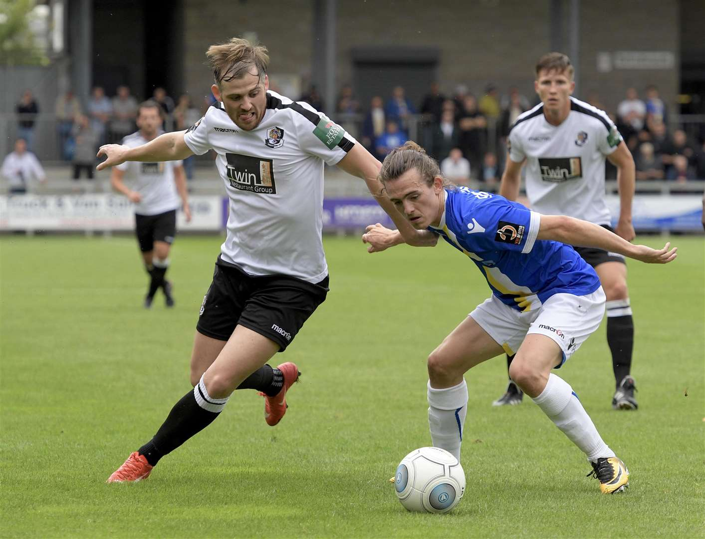 Dartford's Tom Murphy battles for possession Picture: Andy Payton