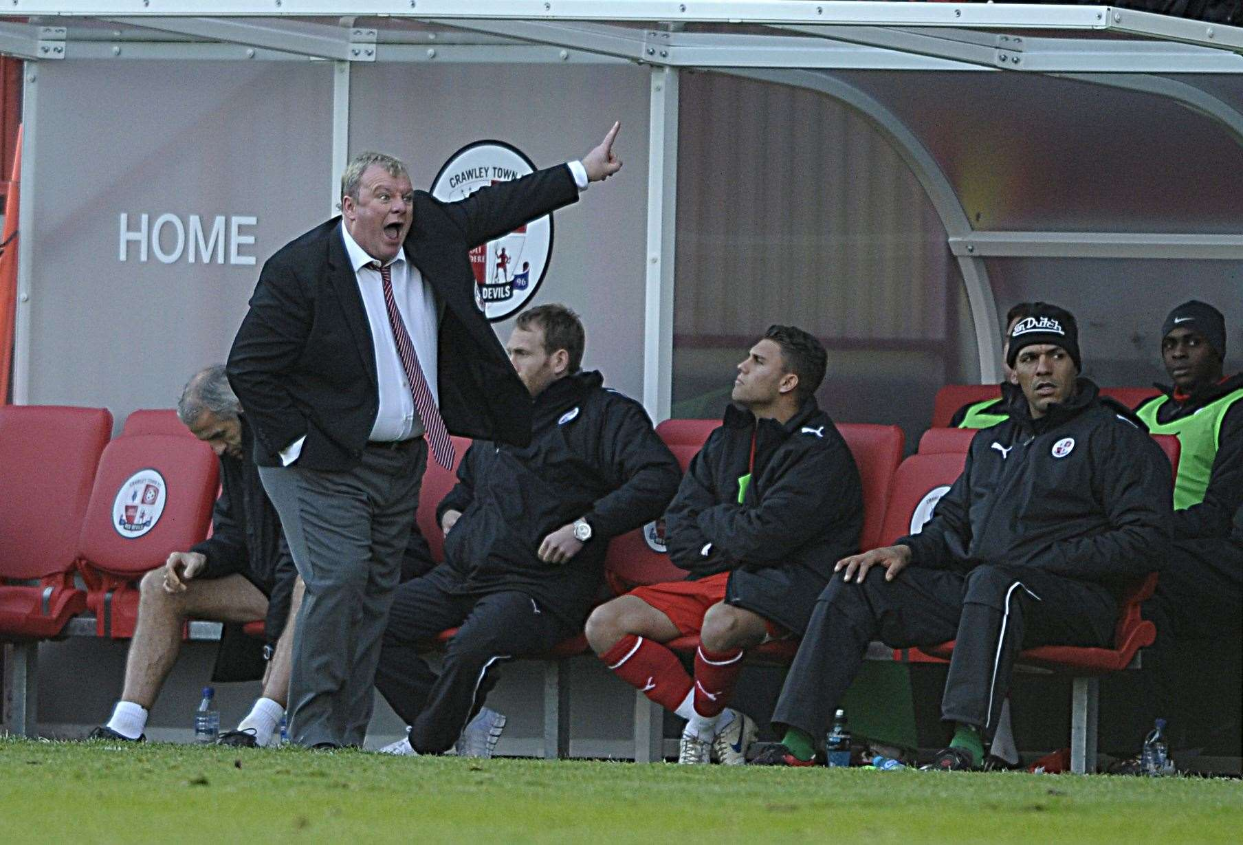 Steve Evans argues with Gills' former boss Andy Hessenthaler during a heated game at Crawley Town Picture: Barry Goodwin