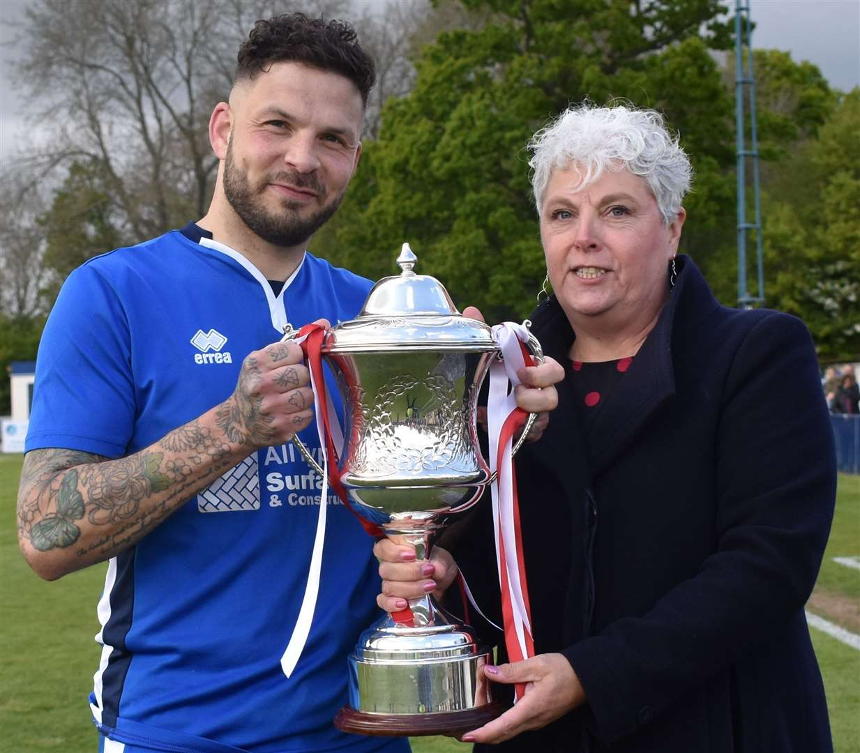 Chatham skipper Paul Vines receives the trophy from SCEFL chairman Denise Richmond. Picture: Alan Coomes