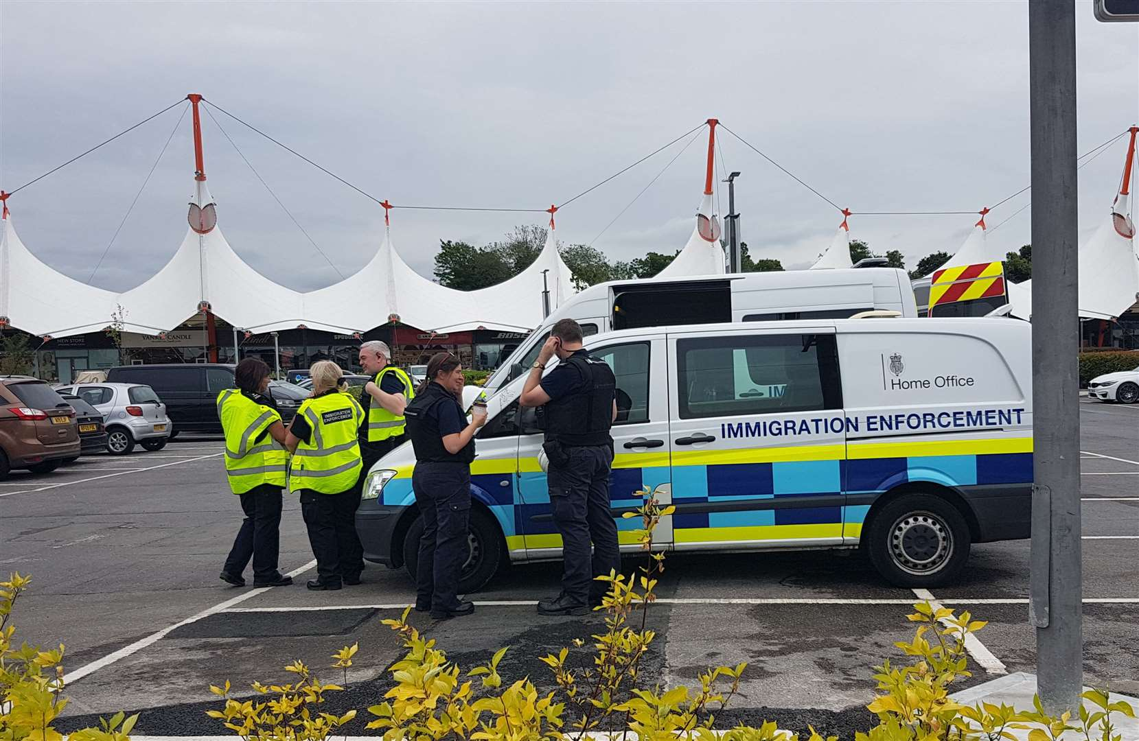 Three Home Office vehicles are currently stationed in the Ashford Designer Outlet car park (13604277)
