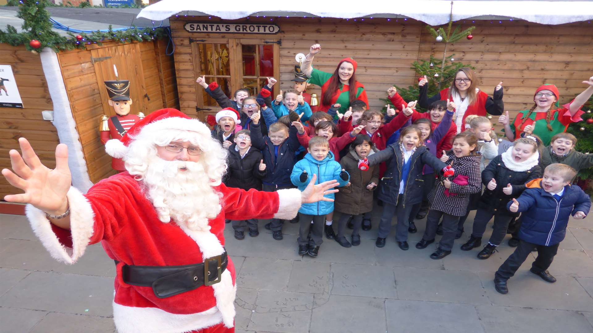 Class 3 of St Peter's Methodist Primary School collect their prize of a visit to Santa's grotto in Whitefriars after winning a walk to school challenge.