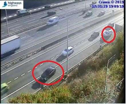 CCTV shows the two cars stranded on the hard shoulder. Photo: Highways England