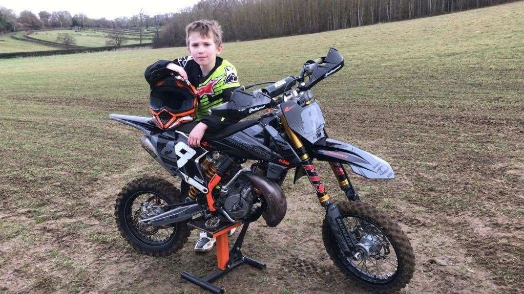 Nine-year-old Christian Davis with his bike which was stolen on Monday
