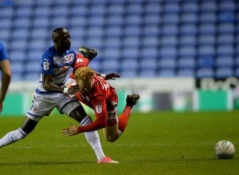 Connor Ogilvie battles for the ball at Reading Picture: Ady Kerry