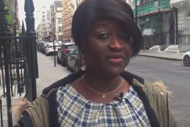 Sarah Kuteh recording a YouTube video explaining why she was dismissed for telling patients about her Christian faith