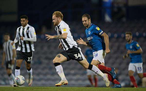 Gillingham's Connor Ogilvie gets away from Brett Pitman Picture: Ady Kerry (3979534)
