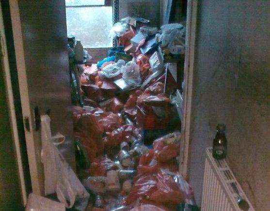 Bags of rubbish can be seen in a home