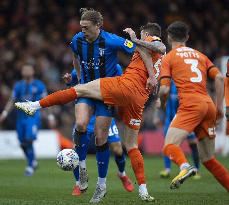 Tom Eaves takes on Luton's Sonny Bradley Picture: Ady Kerry
