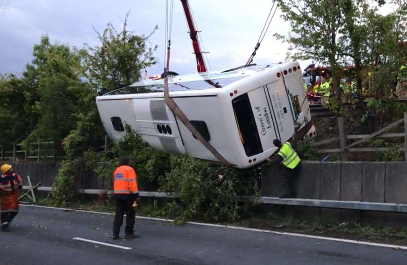 Emergency service workers recovering the overturned coach