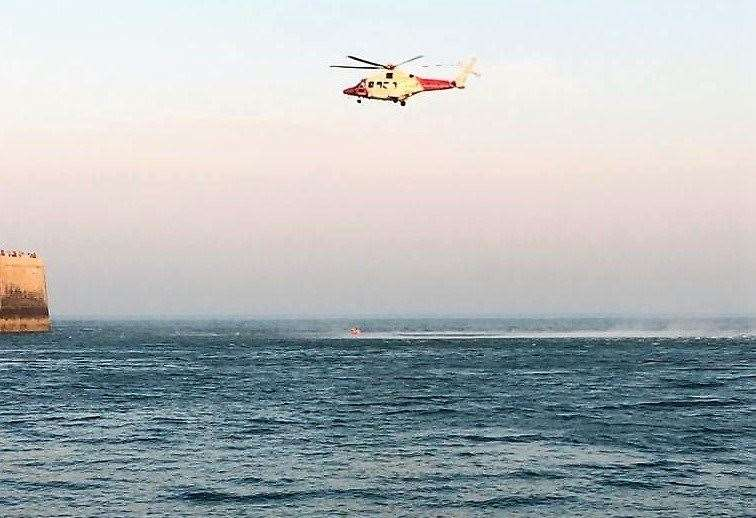 A man was airlifted out of the water at Folkestone after getting into difficulty. Picture: Folkestone Coastguard