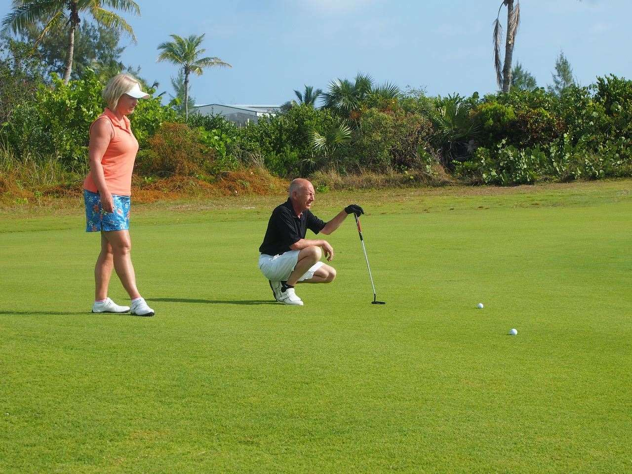 Allan and Sharon Jordan getting some putting practice in on a golf course