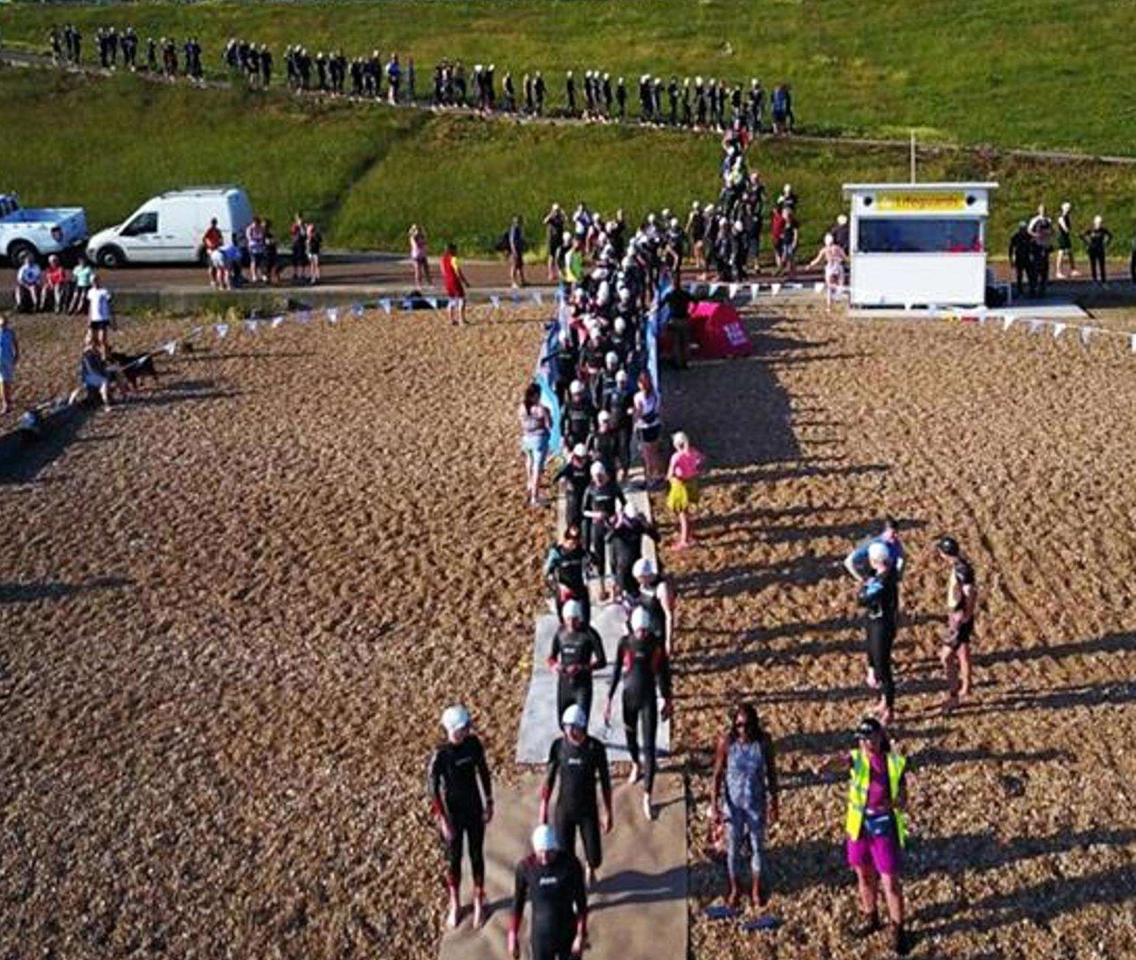 Competitors in last year's Oysterman Triathlon make their way down to the swim