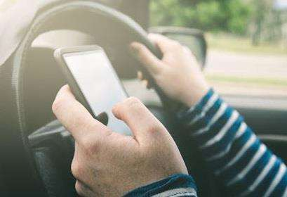 It's a criminal offence to use a mobile phone while driving
