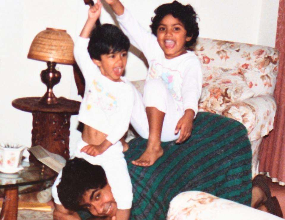 An old photograph of Lakshman with his sons Jonathan and James, now 32 and 30.