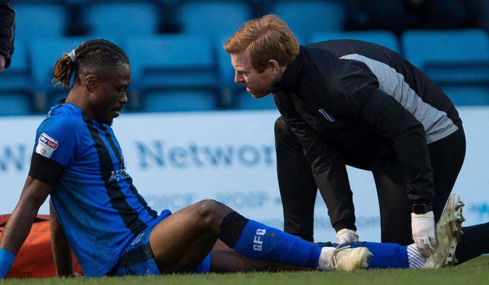 Gabriel Zakuani receives treatment on his injured ankle Picture: Ady Kerry