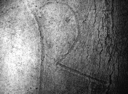 The letter R on the Roman curse scroll as seen through a scanning electronic microscope. Picture: Paul Tritton