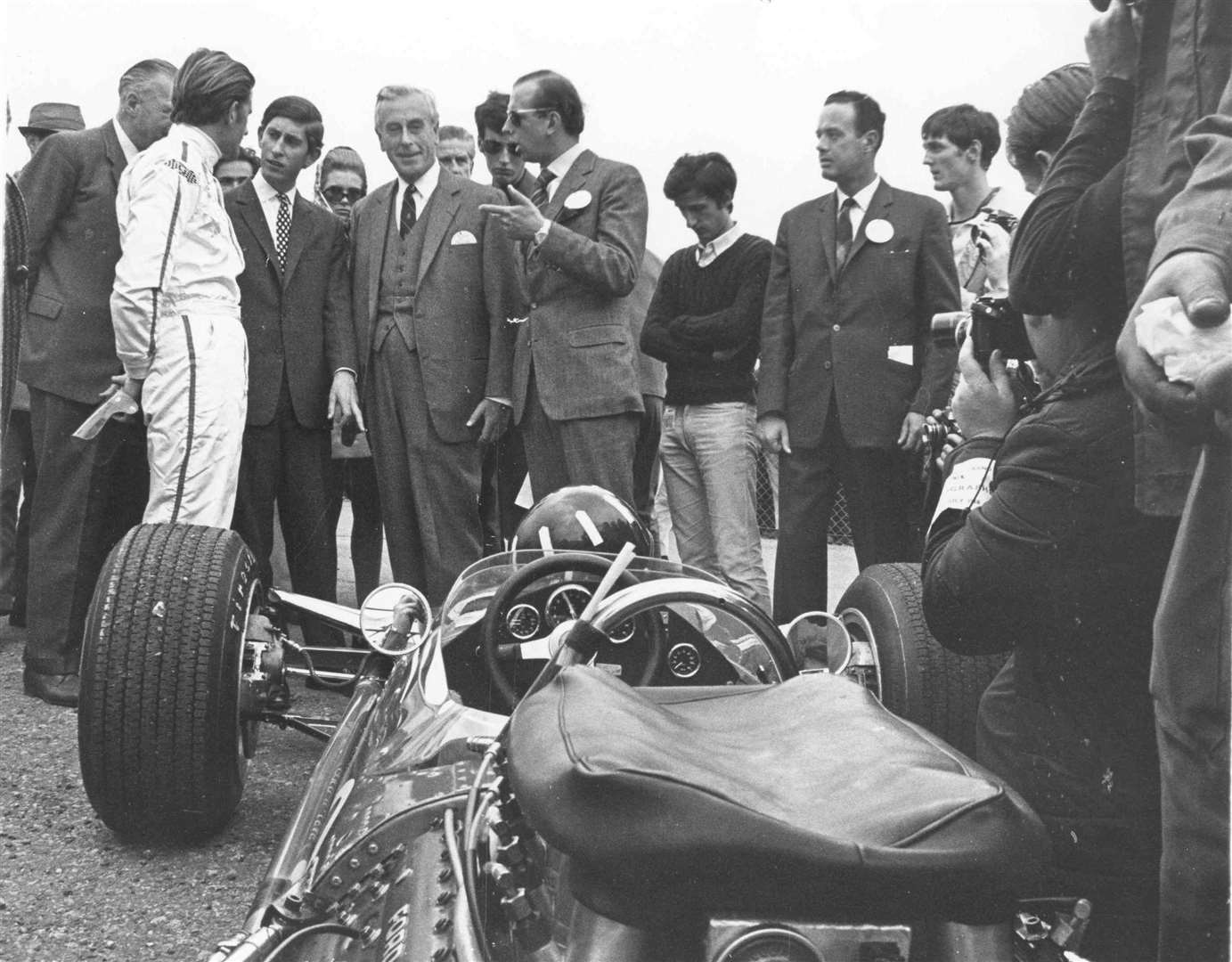 July 1968: Prince Charles drove to Brands Hatch in his blue MGC GT car, where he went to the paddock and met some of the top Grand Prix stars including John Surtees, Graham Hill - pictured here - and Denny Hulme