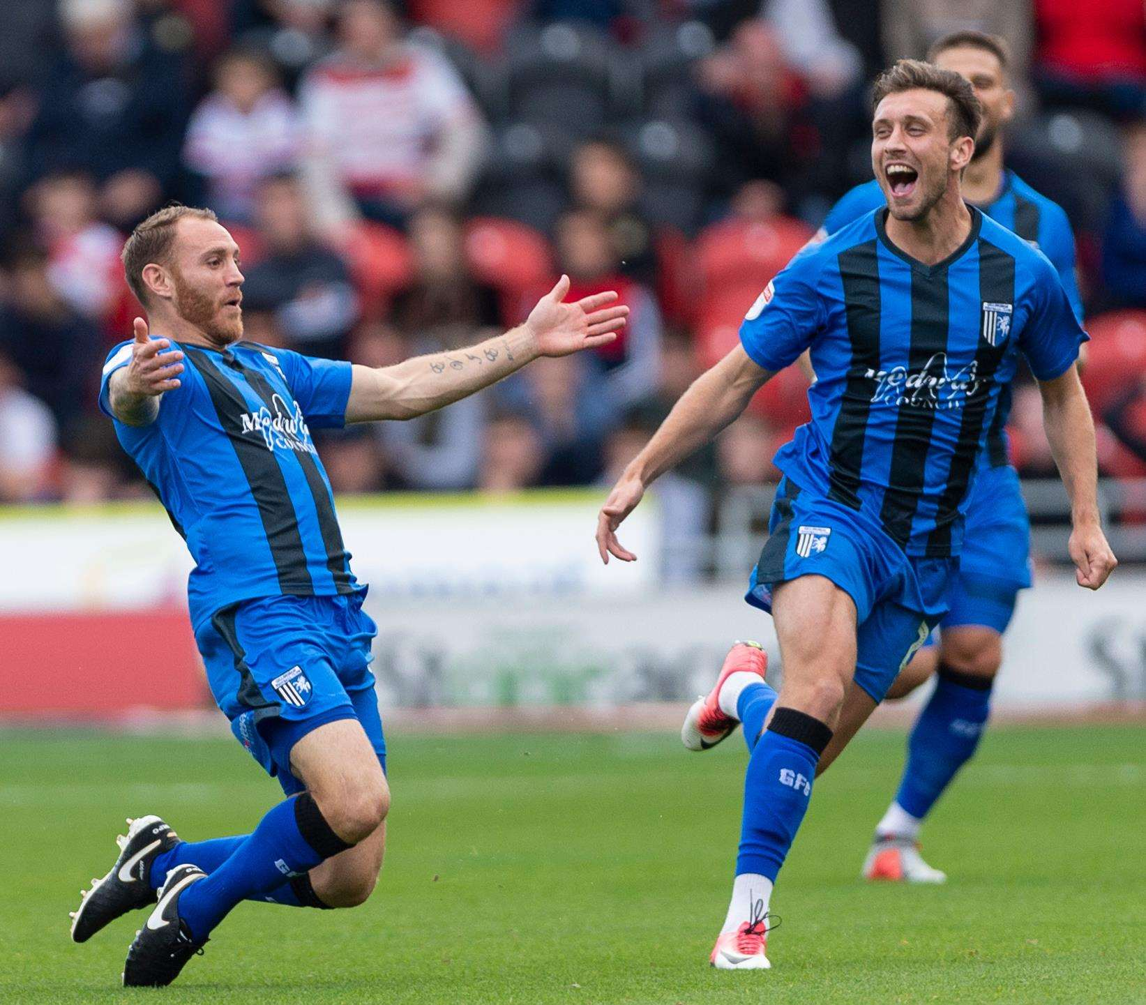 Gillingham's Barry Fuller celebrates scoring the opening goal at Doncaster. Picture: Ady Kerry