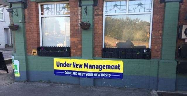 The 'under new management' sign has pride of place on the front wall