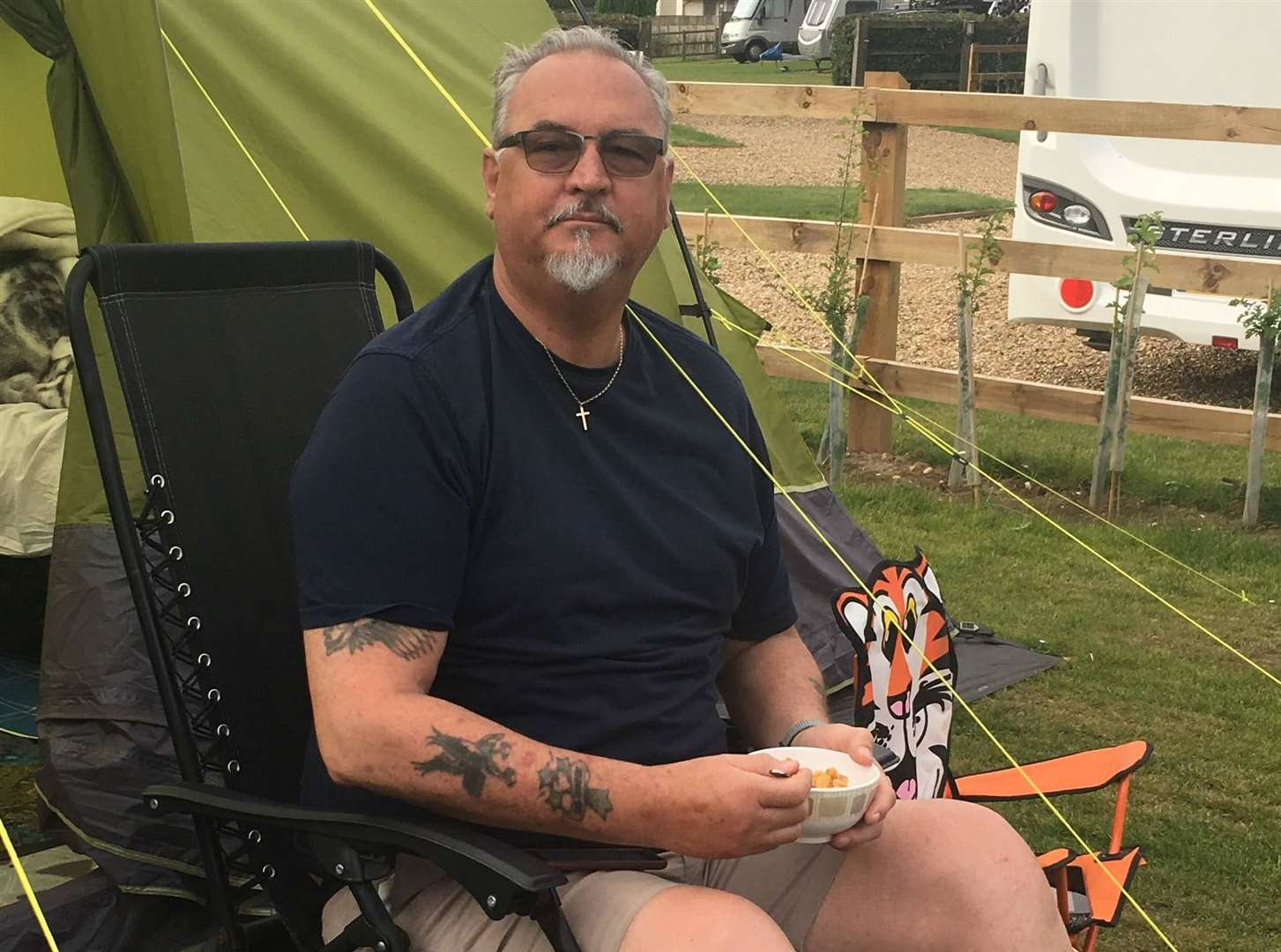 Dave Manser enjoying a camping trip to Norfolk to celebrate his 66th birthday a week before his death