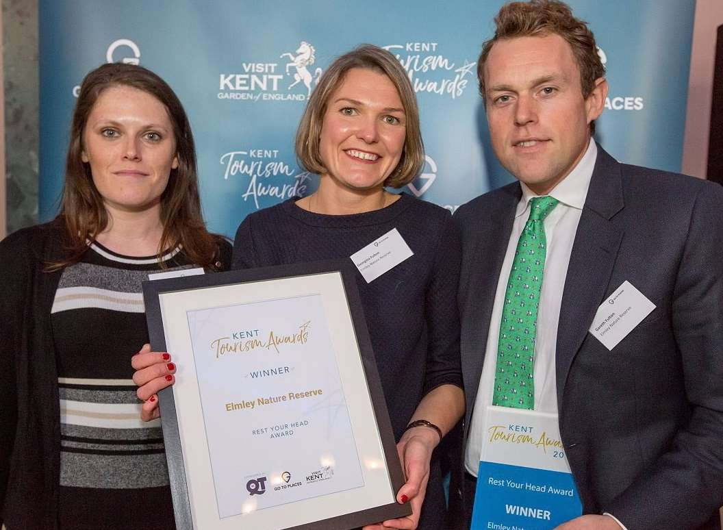 Stephanie Currie from Quality in Tourism, left, presents the award to Georgina and Gareth Fulton of Elmley Nature Reserve