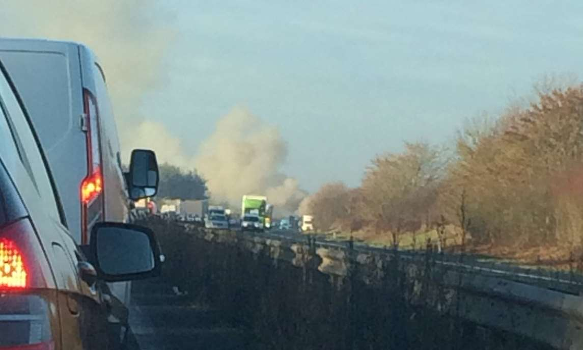 Smoke can be seen pouring across the carriageway. Picture: Adam Dench
