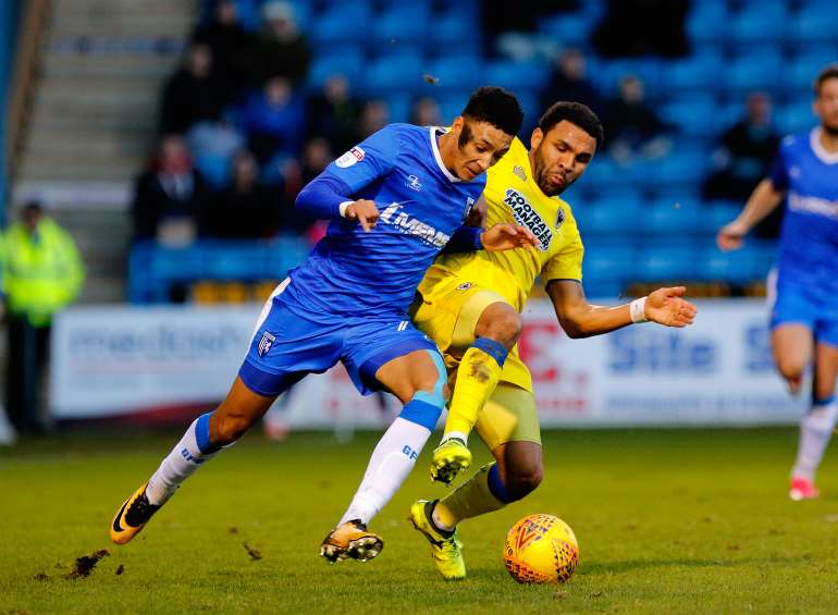 Sean Clare up against former Gills man Andy Barcham Picture: Andy Jones