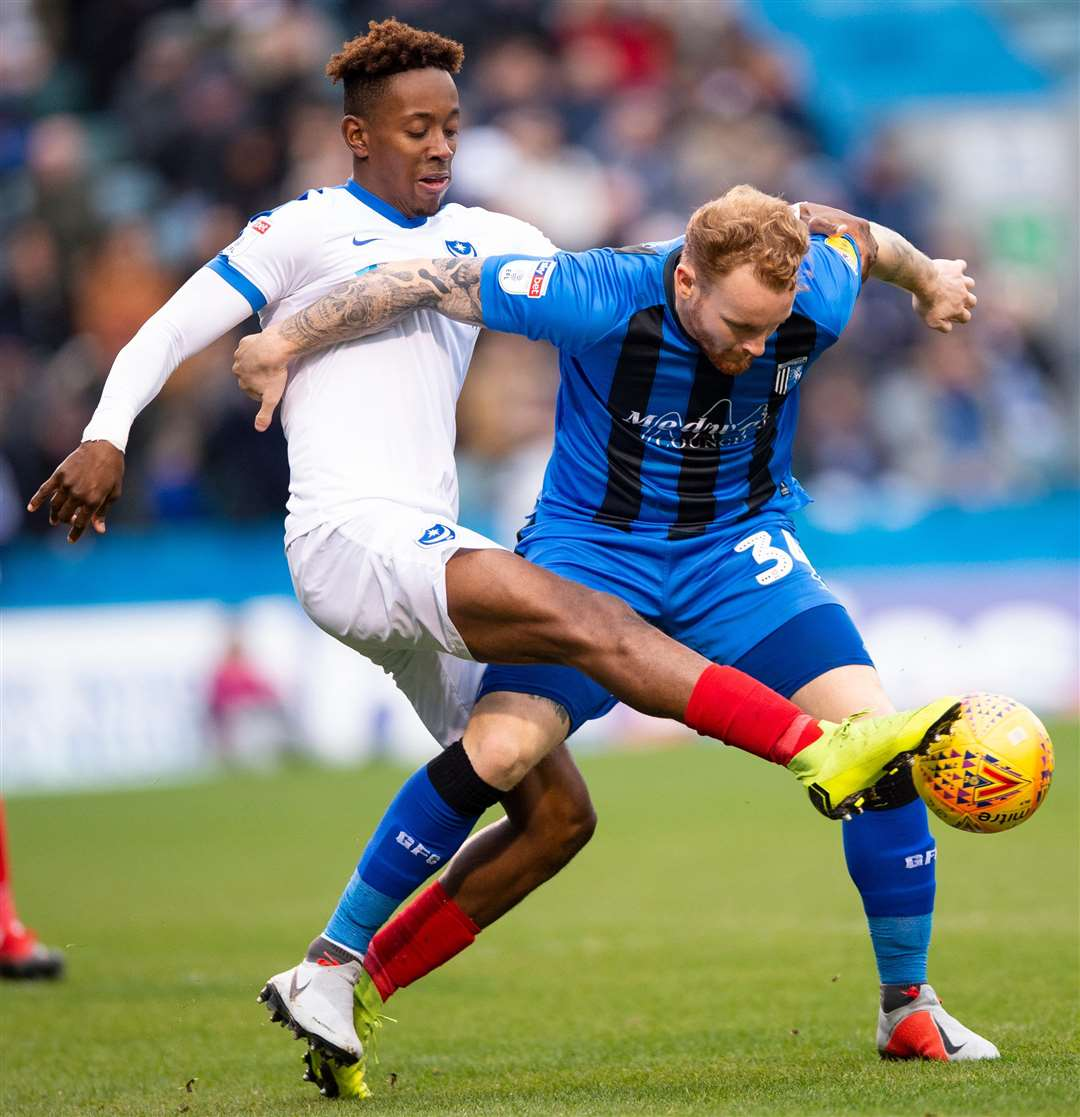 Gillingham's Connor Ogilvie holds off Jamal Lowe. Picture: Ady Kerry