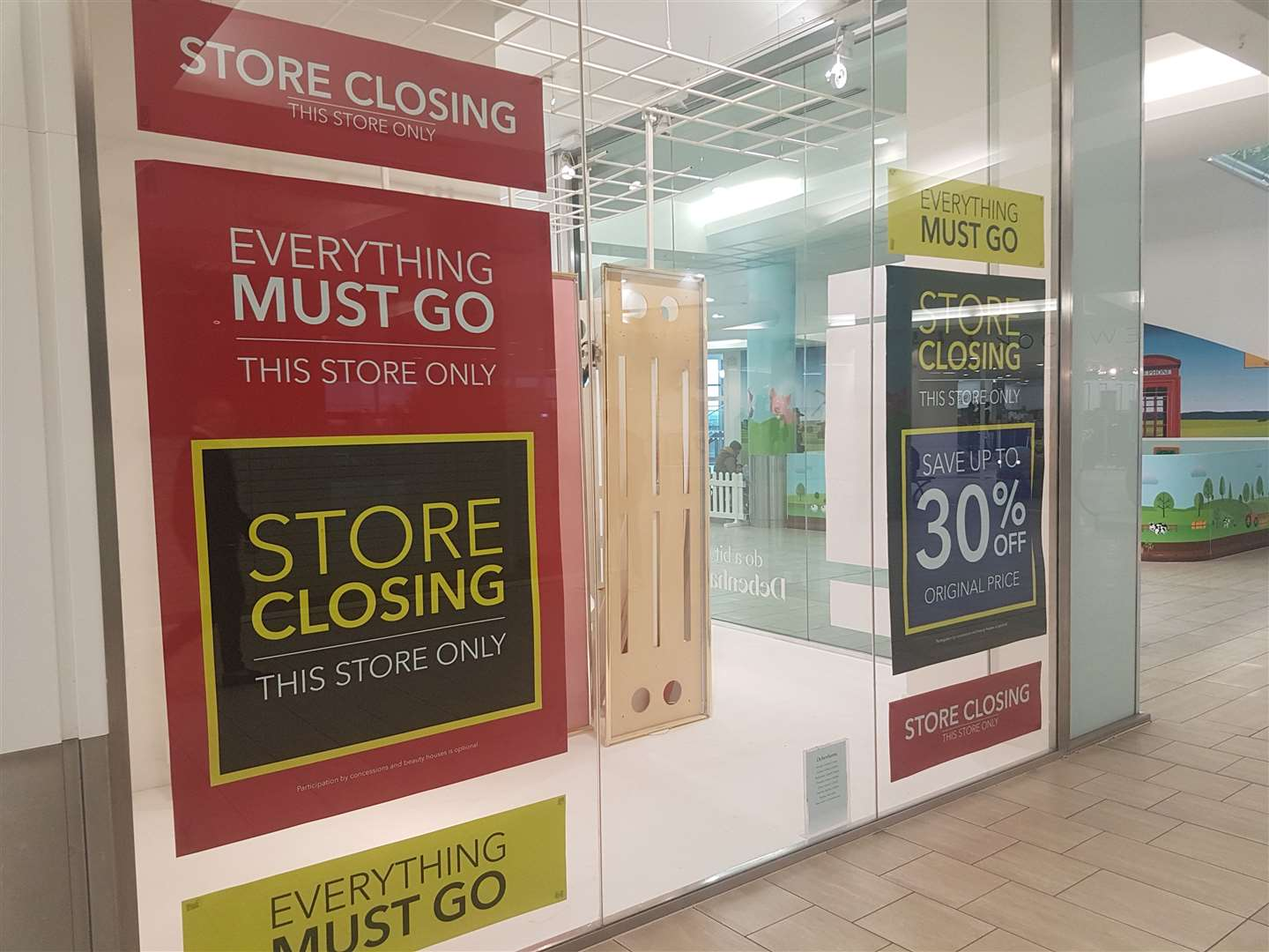 Ashford's Debenhams store has closing down sale decals plastered over its windows (19998586)